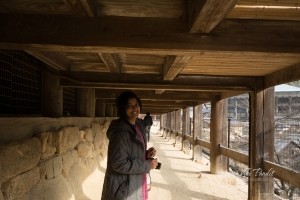 Walking under Senjokaku Hall in Miyajima